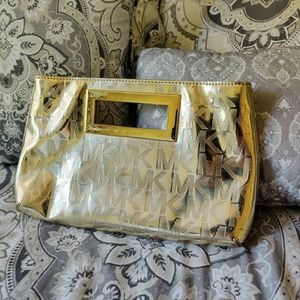 Gold Micheal Kors clutch purse